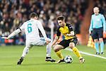 Borussia Dortmund Defender Raphael Guerreiro (R) fights for the ball with Nacho Fernandez of Real Madrid (L) during the Europe Champions League 2017-18 match between Real Madrid and Borussia Dortmund at Santiago Bernabeu Stadium on 06 December 2017 in Madrid Spain. Photo by Diego Gonzalez / Power Sport Images