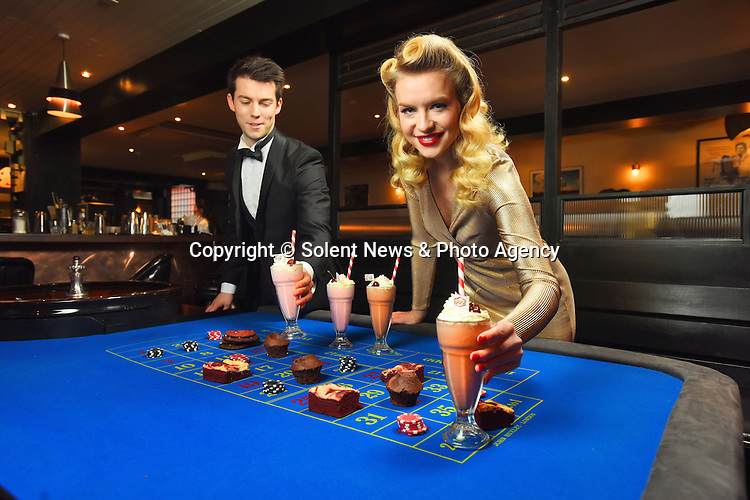 Pictured:  Former Miss England, Kirsty Rose Heslewood, shakes things up on the roulette table.<br /> <br /> A gaming site has launched the world's first ever 'food casino' - where gamblers bet with potato chips to win steaks, milkshakes and desserts.  The bizarre casino, called Raise the Steaks, has been set up in London by 1950's inspired gaming site 777.<br /> <br /> Unlike most restaurants, visitors are actively encouraged to play with their food in a number of casino games which have been reinvented to incorporate dishes from the diner as currency and prizes.  Guests are able to win side dishes and main courses - including steaks - from the menu by gambling with potato chips on a roulette table.  SEE OUR COPY FOR DETAILS.<br /> <br /> &copy; Solent News &amp; Photo Agency<br /> UK +44 (0) 2380 458800