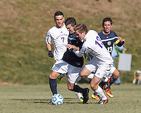 Brandeis forward Tyler Savonen (8) and Williams midfielder Noah Grumman (13) battle for the ball.  NCAA Division III Sectionals. Williams College (white) defeated Brandeis University (blue/white), 2-0, on Hitchcock Field at Amherst College on November 23, 2013.