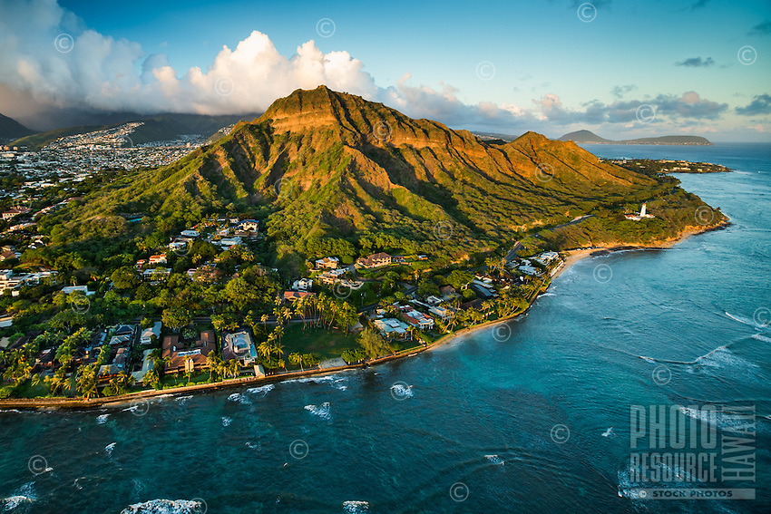 An aerial view of Diamond Head Crater and the Gold Coast of O'ahu at sunset.