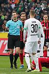 01.12.2019, Borussia Park , Moenchengladbach, GER, 1. FBL,  Borussia Moenchengladbach vs. SC Freiburg,<br />  <br /> DFL regulations prohibit any use of photographs as image sequences and/or quasi-video<br /> <br /> im Bild / picture shows: <br /> Schiedsrichter / referee Felix Zwayer (SR) beruhigt die Spieler <br /> <br /> Foto © nordphoto / Meuter