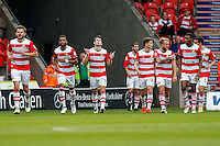 John Marquis of Doncaster Rovers (3rd left) celebrates after he scores his team's second goal of the game to make it 2-1 during the Sky Bet League 2 match between Doncaster Rovers and Wycombe Wanderers at the Keepmoat Stadium, Doncaster, England on 29 October 2016. Photo by David Horn.