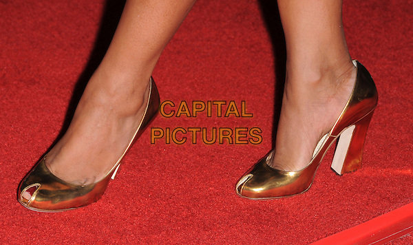 "GARCELLE BEAUVAIS-NILON.Attends The Warner Brothers' Pictures U.S. Premiere of ""10,000 BC"" held at Grauman's Chinese Theater in Hollywood, California, USA, .March 05 2008.                                                                     feet shoes gold peep-toe detail close-up.CAP/DVS.??Debbie VanStory/Capital Pictures"