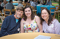 From left, Robert Jackson, graduate Lily Jackson and Debbie Warren. Graduating seniors and their families and friends attend Brunch with President Jonathan Veitch at Collins House, May 16, 2015. (Photo by Marc Campos, Occidental College Photographer)