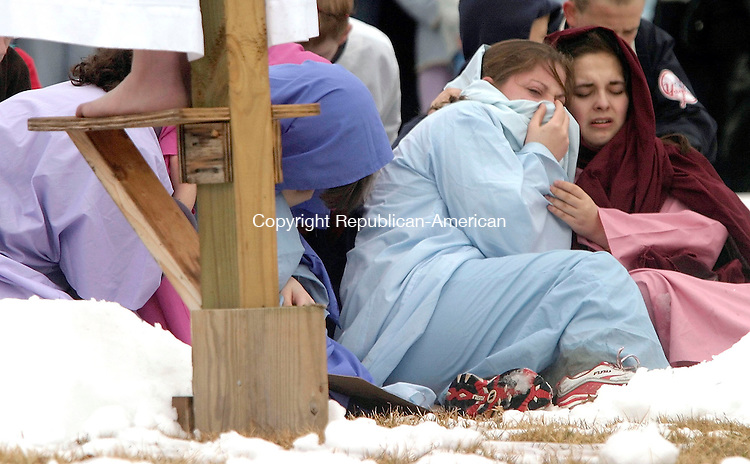 SOUTHBURY, CT- 25 MARCH 2005-032505J11--- Mary, mother of Jesus, played by Jenn Zukoski, 17, of Southbury, left and Mary Magdalene, played by Megan Olena, 17, of Southbury, weep at the foot of the cross as Jesus, played by Dom Narducci of Southbury, is crucified on the cross during the annual Good Friday Faith Walk sponsored by Southbury churches. The event, which dramatizes the Stations of the Cross, finished at the Sacred Heart Church in Southbury. -- Jim Shannon Photo--Good Friday Faith Walk; Southbury; Jesus; Dom Narducci; Sacred Heart Church; Jenn Zukoski; Mary Magdalene, Megan Olena are CQ