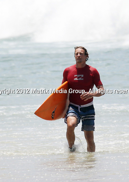 29/12/2011. Sydney, Australia...EXCLUSIVE..Simon baker enjoys family time with wife and kids on the beach. 29/12/2011..EXCLUSIVE..Simon Baker enjoys family time with wife and kids on the beach at Byron Bay...*No internet without clearance*.MUST CALL PRIOR TO USE ..02 9211-1088.Matrix Media Group.Note: All editorial images subject to the following: For editorial use only. Additional clearance required for commercial, wireless, internet or promotional use.Images may not be altered or modified. Matrix Media Group makes no representations or warranties regarding names, trademarks or logos appearing in the images.