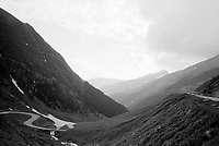 ROMANIA / Transylvania / Fagaras Mountains / June 2007 ..A view along the Transfagarasan Road (the 7C) built by Ceausescu in the 1970s over one of Romania's highest mountains. It was another megalomaniacal project by the dictator but was also conceived as a way to secure an escape route between the provenances of Transylvania and Wallachia to the south if the the Soviets ever invaded as they had Czechoslovakia in 1968. Romania's highest paved road, it is a harrowing driving experience as guardrails are non-existent. The road is often closed along its upper parts into June because of snow...© Davin Ellicson / Anzenberger