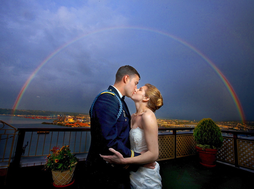 Karen and Chris share a kiss under a perfect rainbow during their wedding in Tacoma, WA. (Photo by Scott Eklund/Red Box Pictures)