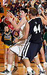 SPEARFISH, SD - FEBRUARY 2, 2013:  Riley Ryan #32 of Black Hills State drives on Jonathon Morse #44 of Metro State during their Rocky Mountain Athletic Conference men's basketball game Saturday evening at the Donald Young Center in Spearfish, S.D.  (Photo by Richard Carlson/dakotapress.org)