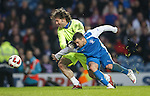 Nacho Novo spots an opportunity and heads the ball out of Ronald Wattereus' hands