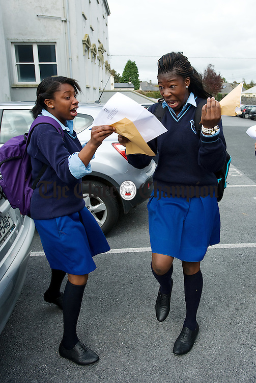 Rianat Sobayo and Joy Ogandare celebrate on getting their Junior Cert results at Colaiste Muire Ennis. Photograph by John Kelly.