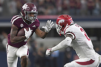 NWA Democrat-Gazette/J.T. WAMPLER Arkansas' Chase Hayden tries to tackle Texas A&M's Camron Buckley Saturday Sept. 29, 2018 at AT&T Stadium in Arlington. The Aggies beat the Razorbacks 24-17.