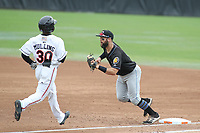 Bowie, MD - May 6, 2018: Akron RubberDucks third baseman Joe Sever (9) tags out Bowie Baysox center fielder Cedric Mullins (30) during the MiLB game between Akron and Bowie at  Baysox Stadium in Bowie, MD.  (Photo by Elliott Brown/Media Images International)