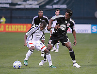 New England Revolution midfielder Sainey Nyassi (31) shields the ball against DC United forward Luciano Emilio (11) DC United tied The New England Revolution 1-1 at  RFK Stadium, Friday April 17, 2009.