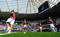 Swansea City Players during the pre-match warm-up for the Sky Bet Championship match between Swansea City and Rotherham United at the Liberty Stadium in Swansea, Wales, UK.  Friday 19 April 2019
