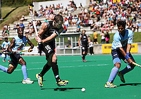 Goalscorer Phillip Burrows takes a shot at goal during the international hockey match between the New Zealand Black Sticks and India at National Hockey Stadium, Wellington, New Zealand on Saturday, 20 February 2009. Photo: Dave Lintott / lintottphoto.co.nz