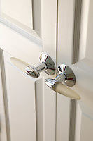 Modern white glass and chrome door handles