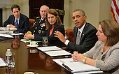United States President Barack Obama (2nd,R) makes remarks as (L-R) CDC Director Tom Frieden, Chairman of the Joint Chiefs Gen. Martin Dempsey, US Secretary of Health and Human Services Sylvia Burwell, and Homeland Security official Lisa Monaco listen during a meeting with his national security team and senior staff for an update on the Ebola crisis in West Africa, at the White House, October 6, 2014, in Washington, DC.   <br /> Credit: Mike Theiler / Pool via CNP