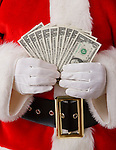 USA, Illinois, Metamora, Studio shot of Santa holding fan of one dollar banknotes, mid section