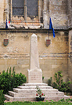VMI Vincentian Heritage Tour: Memorial to the war dead outside the Church of Saint-Jacques-Le-Majeur et Saint-Jean-Baptiste, where Vincent spoke in 1617, a sermon credited for the creation of the Congregation of the Mission. Members of the Vincentian Mission Institute cohort toured the remains of the church and medieval castle Le château de Folleville, Wednesday, June 22, 2016, in northern France. The manor and castle of Folleville were the property of Philippe Emmanuel de Gondi. Vincent de Paul was the spiritual advisor to Phillippe's wife, Madame de Gondi. (DePaul University/Jamie Moncrief)