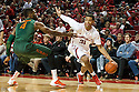 December 4, 2013: Shavon Shields (31) of the Nebraska Cornhuskers drive to the hoop against Raphael Akpejiori (4) of the Miami (Fl) Hurricanes at the Pinnacle Bank Areana, Lincoln, NE. Nebraska defeated Miami 60 to 49.