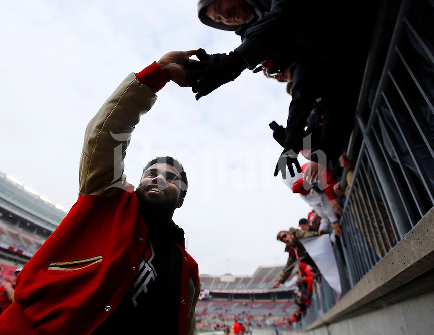 Running back Ezekiel Elliott gives high fives following the Ohio State football National Championship celebration at Ohio Stadium on Saturday, January 24, 2015. (Columbus Dispatch photo by Jonathan Quilter)