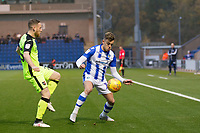Sammie Szmodics of Colchester United shields the ball from Jake Taylor of Exeter City during Colchester United vs Exeter City, Sky Bet EFL League 2 Football at the JobServe Community Stadium on 24th November 2018