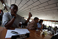 an exporter bids on coffee at the daily coffee auction in Addis Ababa, Ethiopia on Thursday January 25 2007.