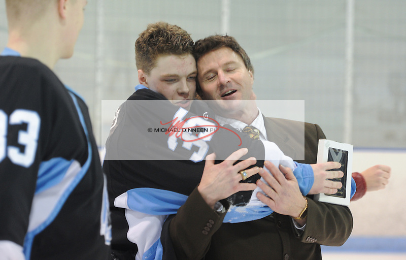 Chugiak coach Rod Wild and all-conference goalie Jack Walters embrace following their championship win over Dimond at Ben Boeke Arena Saturday, February 6, 2016.  At left is goalie Ian Bernard. Photo for the Star by Michael DInneen