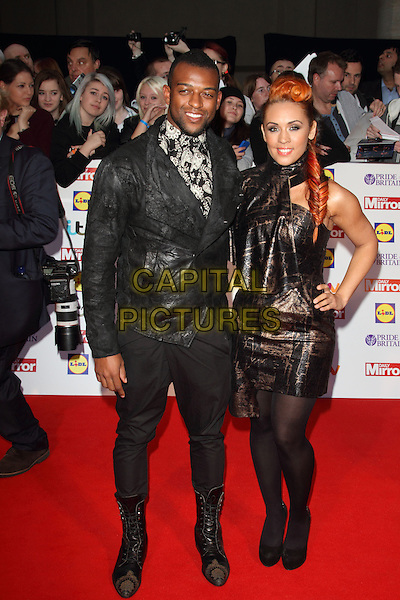 Oritse Williams (of JLS) &amp; AJ Azari<br /> The Daily Mirror's Pride of Britain Awards arrivals at the Grosvenor House Hotel, London, England.<br /> 7th October 2013<br /> full length black suit bronze dress couple<br /> CAP/ROS<br /> &copy;Steve Ross/Capital Pictures