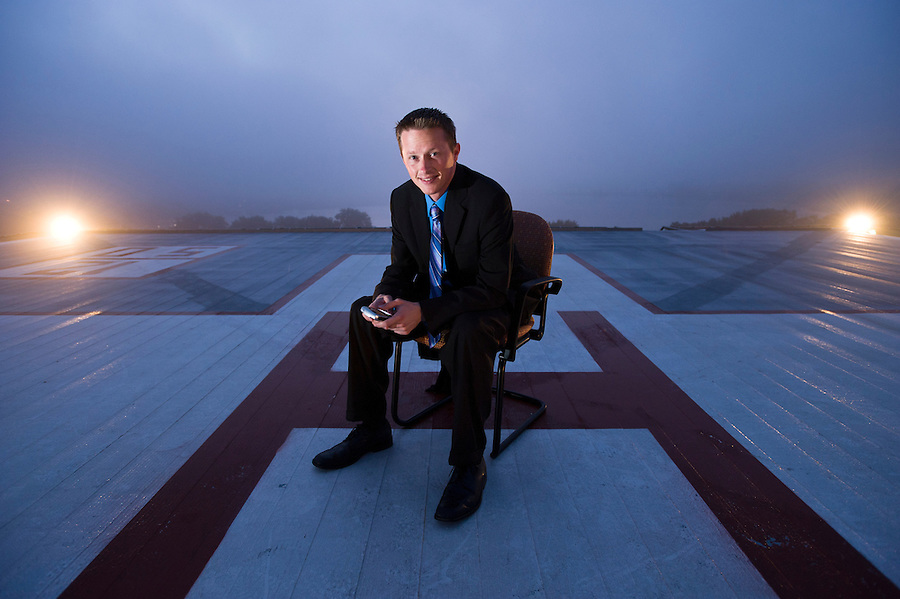 Steve Van Dinter, regional director of media relations and public affairs for SSM Health Care of Wisconsin, is pictured on St. Mary's Hospital's rooftop helipad in Madison, Wis., during a foggy dawn morning on Aug. 14, 2008.