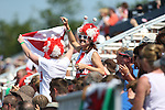 Glasgow 2014 Commonwealth Games<br /> Wales v England<br /> England fans celebrate their teams second goal.<br /> Glasgow National Hockey Centre<br /> <br /> 24.07.14<br /> ©Steve Pope-SPORTINGWALES