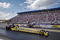 Sep 15, 2013; Charlotte, NC, USA; NHRA top fuel dragster driver Morgan Lucas (near) defeats teammate Brandon Bernstein during the Carolina Nationals at zMax Dragway. Mandatory Credit: Mark J. Rebilas-