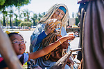 The Roman Catholic Church bought the Crystal Cathedral out of bankruptcy in 2011 and is currently transforming the iconic campus into a cathedral. Construction on Christ Cathedral will be complete in 2016. Children on tour touch &quot;The Holy Family&quot; statue, which depicts Mary and Jesus, on the campus in Garden Grove, California August 5, 2014. <br /> CREDIT: Kendrick Brinson for The Wall Street Journal<br /> OCTV