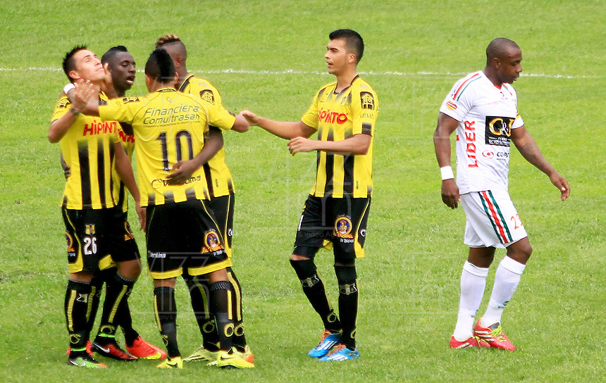 FLORIDABLANCA -COLOMBIA, 28-09-2014.  Jugadores de Alianza Petrolera celebran un gol anotado a Patriotas FC durante encuentro  por la fecha 12 de la Liga Postobon II 2014 disputado en el estadio Alvaro Gómez Hurtado de la ciudad de Floridablanca./ xxx (R) player of Alianza Petrolera fights for the ball with xxx (L) player of Patriotas FC during match for the 12th date of the Postobon League II 2014 played at Alvaro Gomez Hurtado stadium in Floridablanca city Photo:VizzorImage / Duncan Bustamante / STR