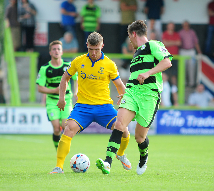 Lincoln City's Jack Muldoon runs at Forest Green Rovers' James Jennings<br /> <br /> Photographer Andrew Vaughan/CameraSport<br /> <br /> Football - Vanarama National League - Forest Green Rovers v Lincoln - Saturday 22nd August 2015 - The New Lawn - Nailsworth<br /> <br /> &copy; CameraSport - 43 Linden Ave. Countesthorpe. Leicester. England. LE8 5PG - Tel: +44 (0) 116 277 4147 - admin@camerasport.com - www.camerasport.com