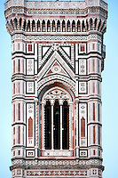 Bell Tower, Cathedral Santa Maria del Fiore, Florence, Italy , also known as the Duomo, begun in 1296 by Arnolfo di CAMBIO, dome by Filippo BRUNELLESCHI, 1377-1446, completed in 1436. Detail of Bell Tower designed by GIOTTO, 1267-1337 pictured on June 10 2007.
