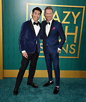 HOLLYWOOD, CA - AUGUST 07: Chris Pang (L) and Brian Tyler arrive at the Warner Bros. Pictures' 'Crazy Rich Asians' premiere at the TCL Chinese Theatre IMAX on August 7, 2018 in Hollywood, California.<br /> CAP/ROT/TM<br /> &copy;TM/ROT/Capital Pictures