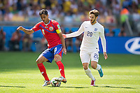 Bryan Ruiz of Costa Rica and Adam Lallana of England