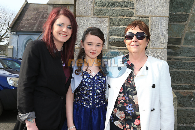 Katie Reilly with Laura Butterly and Agnes Butterly Dunleer Confirmation..Picture: Fran Caffrey / www.newsfile.ie ..