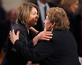 Boston, MA - August 29, 2009 -- U.S. Speaker of the House Nancy Pelosi (L) hugs Angela Menino (R), wife of Boston Mayor Thomas Menino. during funeral services for U.S. Senator Edward Kennedy at the Basilica of Our Lady of  Perpetual Help in Boston, Massachusetts August 29, 2009.  Senator Kennedy died late Tuesday after a battle with cancer.    .Credit: Brian Snyder- Pool via CNP