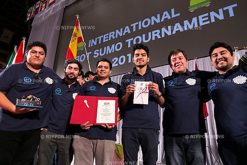 (Second from the left) Robot operators from Mexico Juan Garcia and Adrian Sanchez, runners up of the Radio-controlled robots category, pose for the cameras with their team at the International Robot Sumo Tournament 2015, in the Ryogoku Sumo Hall (Ryogoku Kokugikan) on December 13, 2015. The annual competition brings the winners from 14 robot sumo tournaments held globally, plus the Japanese winners of the All Japan Robot-Sumo National Tournament and All Japan Robot-Sumo Tournament (High-School class) to fight for the world's first place in two divisions: autonomous and radio controlled. The international tournament is part of the All Japan Robot-Sumo Tournament which has been held in various countries since 1989. According to the rules the robot wrestler loses when the robot is forced outside the sumo ring, simulating a traditional sumo fight. (Photo by Rodrigo Reyes Marin/AFLO)
