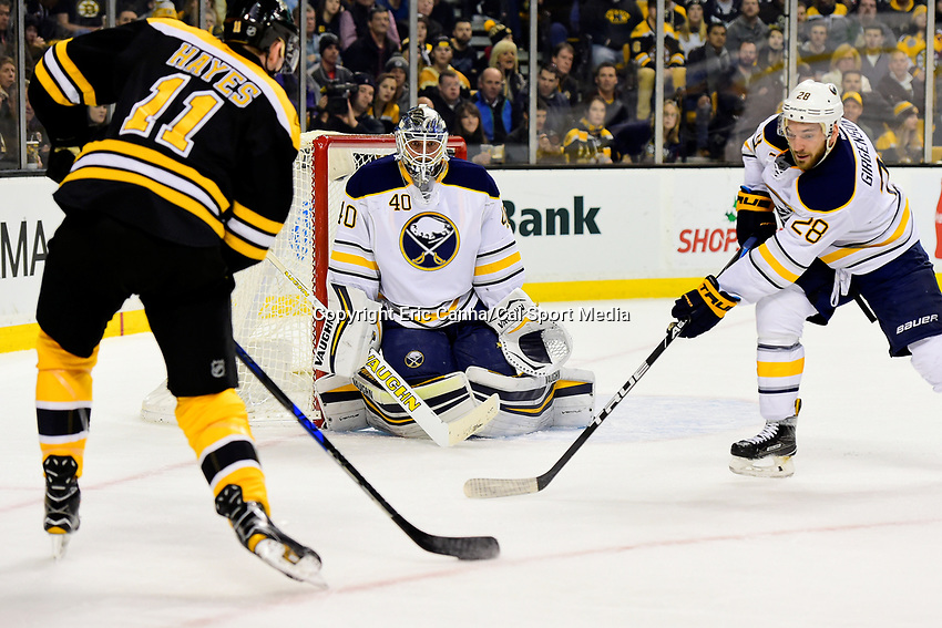 Saturday, December 31, 2016: Buffalo Sabres goalie Robin Lehner (40) focuses on the puck controlled by Boston Bruins right wing Jimmy Hayes (11) during the National Hockey League game between the Buffalo Sabres and the Boston Bruins held at TD Garden, in Boston, Mass. Boston defeats Buffalo 3-1.  Eric Canha/CSM