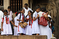 TX0707-D. School girls visiting a temple in Anuradhapura. Sri Lanka. <br /> Photo Copyright © Brandon Cole. All rights reserved worldwide.  www.brandoncole.com