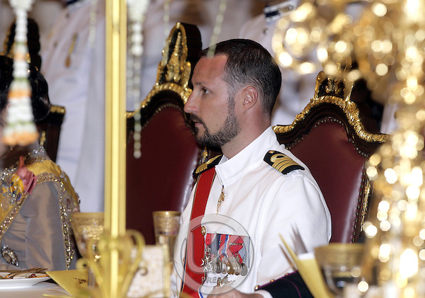 Crown Prince Haakon & Crown Princess Mette-Marit of Norway attend a Banquet for foreign monarchs & royal guests at the Chakri Maha Prasat Throne Hall, hosted by Thai King Bhumibol Adulyadej, during the celebrations to mark the 60th anniversary of his accession to the throne..