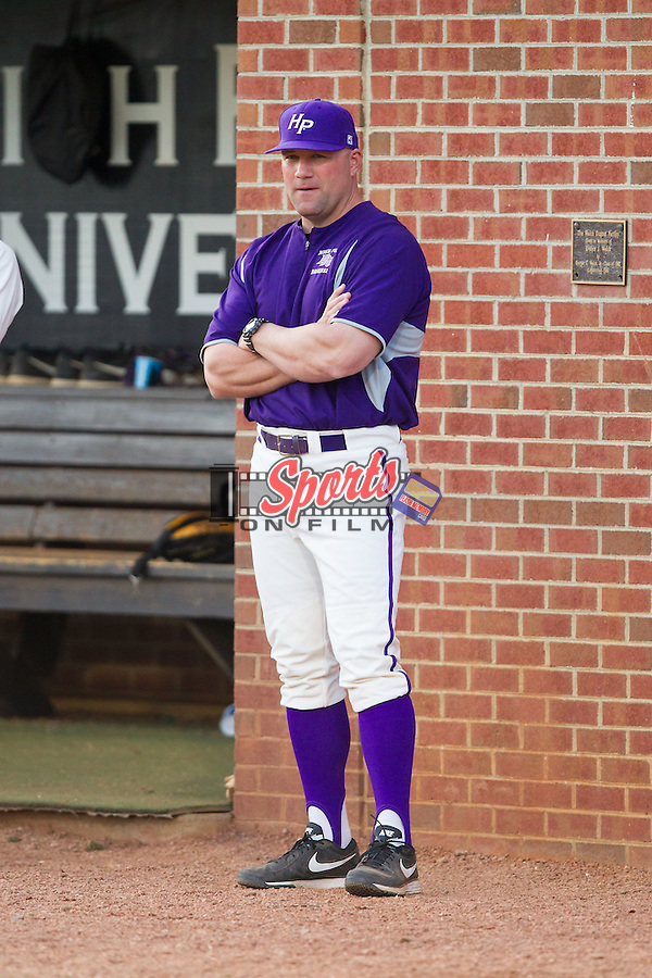 High Point Panthers head coach Craig Cozart (38) watches the action from just outside the dugout during the game against the Coastal Carolina Chanticleers at Willard Stadium on March 15, 2014 in High Point, North Carolina.  The Panthers defeated the Chanticleers 11-8 in game two of a double-header.  (Brian Westerholt/Sports On Film)