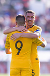 Jamie Maclaren of Australia celebrates scoring the team's first goal with teammate Mark Milligan during the AFC Asian Cup UAE 2019 Group B match between Palestine (PLE) and Australia (AUS) at Rashid Stadium on 11 January 2019 in Dubai, United Arab Emirates. Photo by Marcio Rodrigo Machado / Power Sport Images