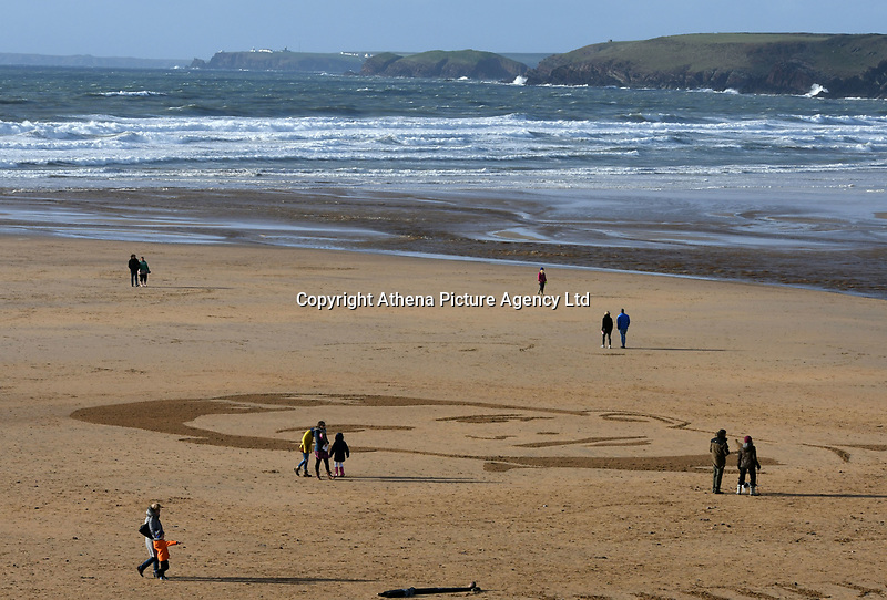 Pictured: A portrait of Major Charles Alan Smith Morris, designed by sand artists Sand In Your Eye, was drawn into the sand of Freshwater West beach, for a Danny Boyle project, in commemoration to the 100 years since the end of the First World War on Remembrance Day, in Pembrokeshire, west Wales, UK. Sunday 11 November 2018