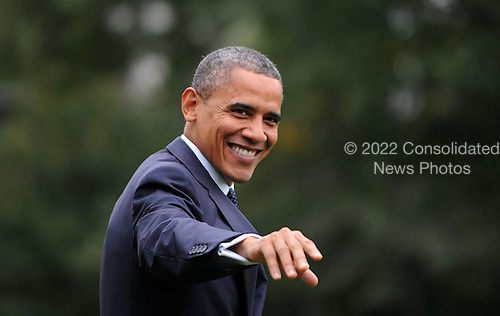 United States President Barack Obama waves as he walks to Marine One on the South Lawn to depart the White House October 7, 2012 in Washington, DC. Obama is heading to a campaign event in Los Angeles, California..Credit: Olivier Douliery / Pool via CNP