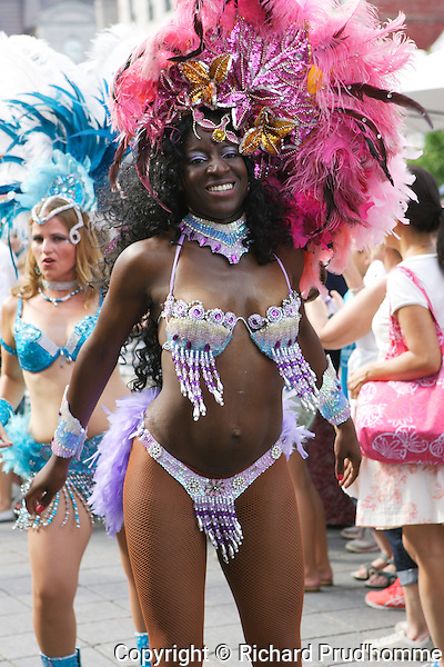 A colorful costumed dancer in the carnival procession